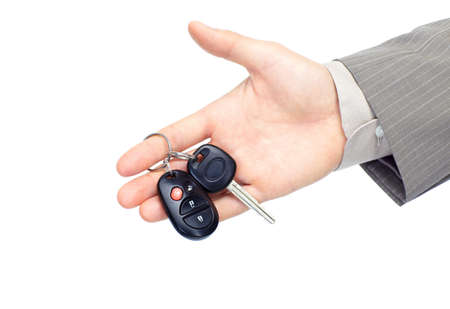 businessman holding car key. Isolated over white background  photo