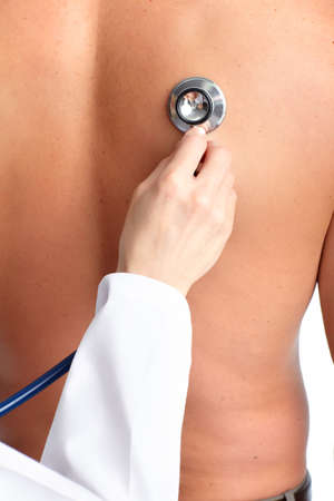 stethoscope: a doctor examining a patient by stethoscope