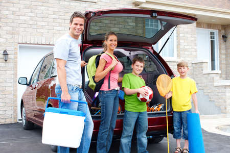 new motor vehicles: Smiling happy family and a family car Stock Photo