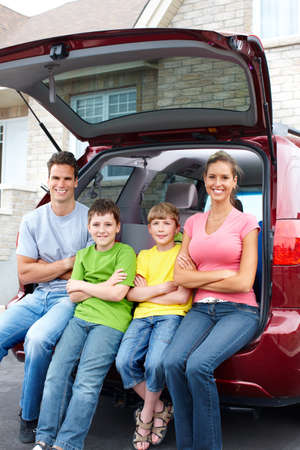 Smiling happy family and a family car Stock Photo