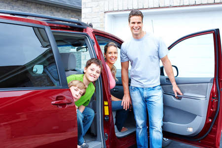 Smiling happy family and a family car Archivio Fotografico