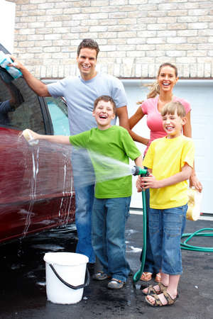 Smiling happy family washing the family car Stock Photo - 8950424