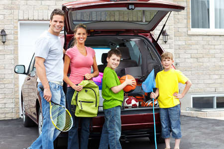 Smiling happy family and a family car Foto de archivo