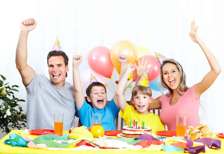 Happy family . Father, mother and children celebrating birthday at home Фото со стока