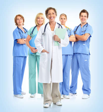 Smiling doctors with stethoscopes. Over blue  background