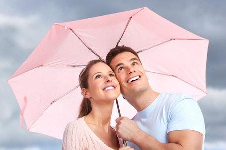 woman umbrella: couple under umbrella Stock Photo