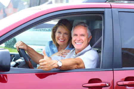 new motor car: Senior couple in the car