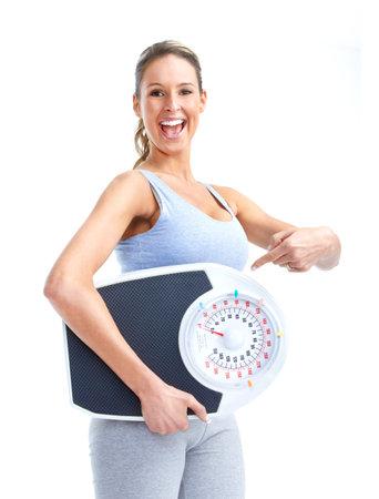 gewicht skala: Frau mit einer Waage