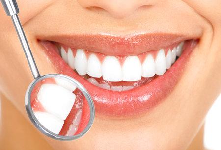 Teeth with mirror. Dental health. Stock Photo - 9109362