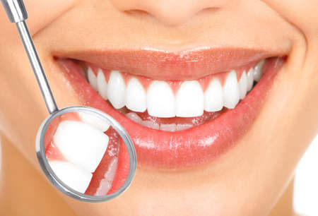 Teeth with mirror. Dental health. photo