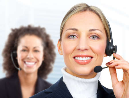 Beautiful  customer service operator woman with headset. Over white background Stock Photo - 9109365