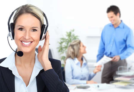 customer service representative: Business woman with headset in the office. Stock Photo