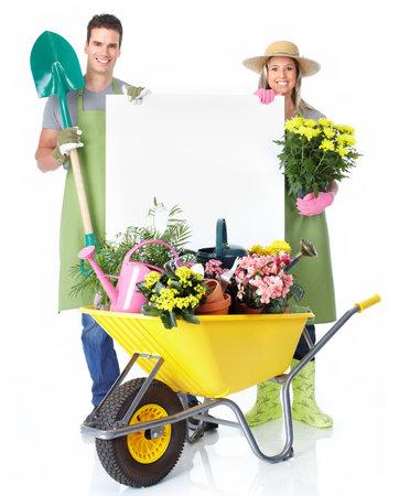woman gardening: Gardening couple. Isolated over white background. Stock Photo