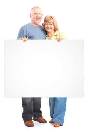 Senior couple with poster. Isolated over white background. Zdjęcie Seryjne