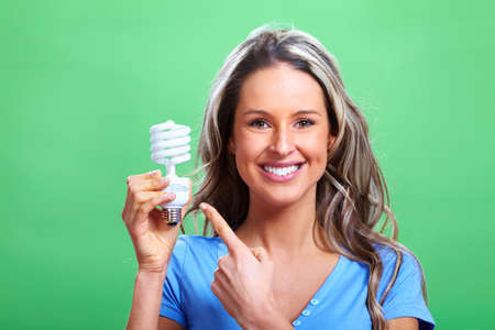 Woman with a fluorescent bulb photo