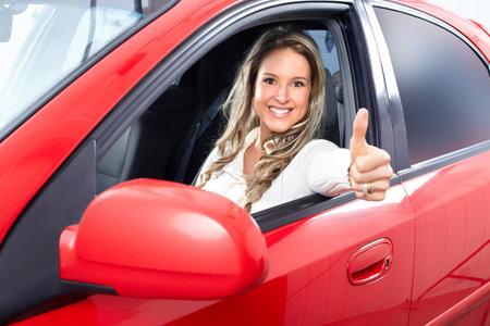 ubezpieczenia: Kobieta w samochodzie Zdjęcie Seryjne