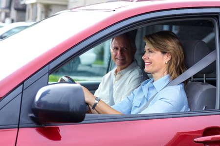 senior couple in auto.  Stock Photo