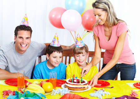Family celebrating birthday at home. photo
