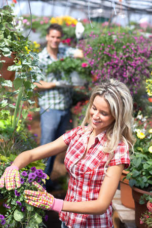 Florist woman. people in the garden photo