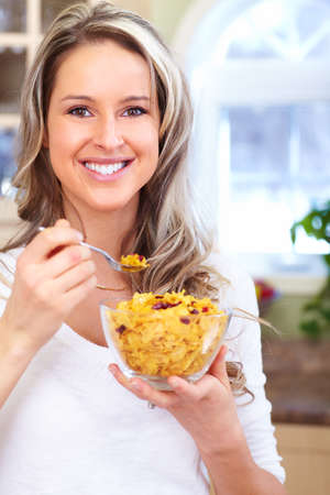 Woman eating cereals photo
