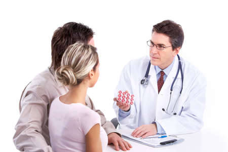 doctor with pills: doctor and young couple