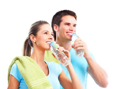 man drinking water: Fitness and gym.