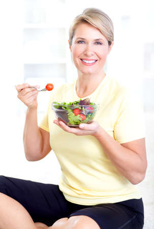 woman eating salad Stock Photo - 9406848
