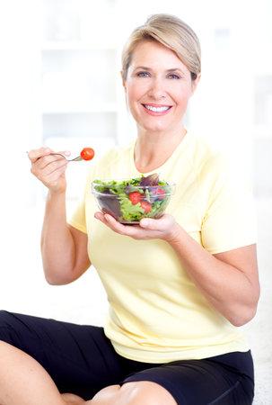woman eating salad Stock Photo - 9406848