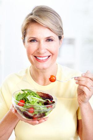 woman eating salad Stock Photo - 9406920
