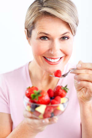 woman eating salad photo