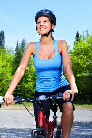 Woman cyclist. Reklamní fotografie