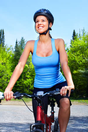 free riding: Woman cyclist. Stock Photo