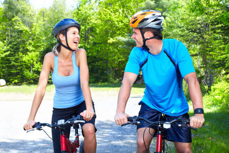 cycling   helmet: Riding couple.
