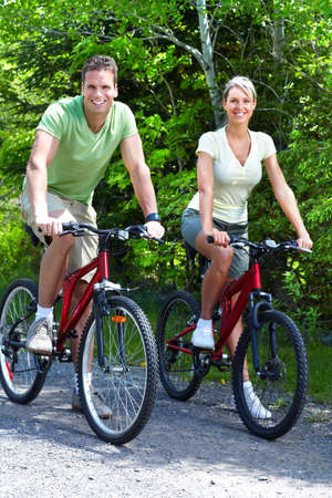 velo: Riding couple.