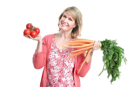 Elderly woman with vegetables. Isolated over white background. photo