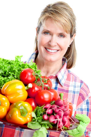Senior woman  with vegetables. Gardening.  Isolated over white background. photo