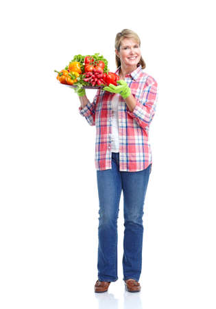 Gardening woman  with vegetables.  Isolated over white background. photo