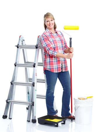Painter woman. Isolated over white background. Renovation. photo