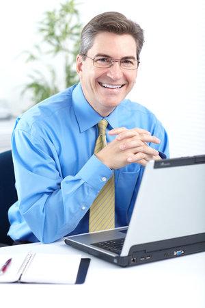 Smiling business man. Modern office. 免版税图像