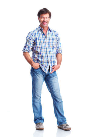 man standing with hands in pocket, smiling