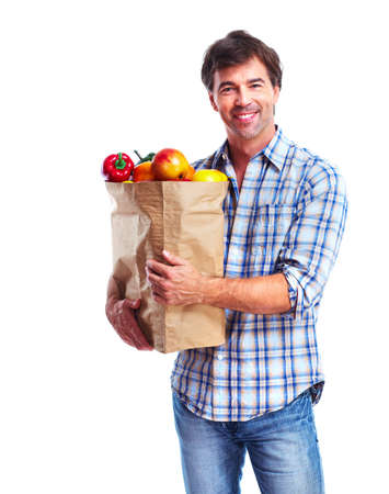 man holding a bag of grocery photo