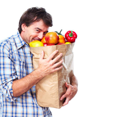 man holding a bag of grocery Stock Photo - 10501078
