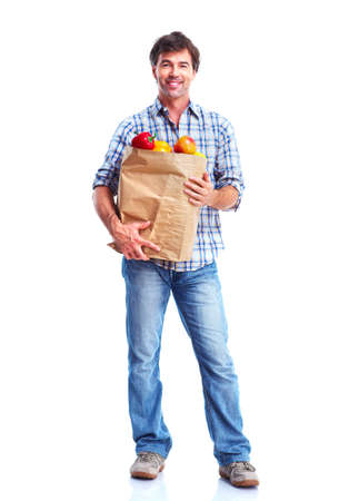 man holding a bag of grocery, smiling photo