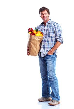groceries: hombre que sostiene una bolsa de supermercado Foto de archivo