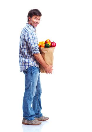 groceries: hombre sosteniendo una bolsa de supermercado Foto de archivo