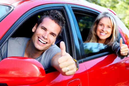woman driving car: Happy couple.