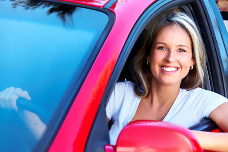 woman driving car: Happy woman.