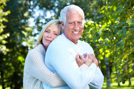 two women hugging: Senior couple.
