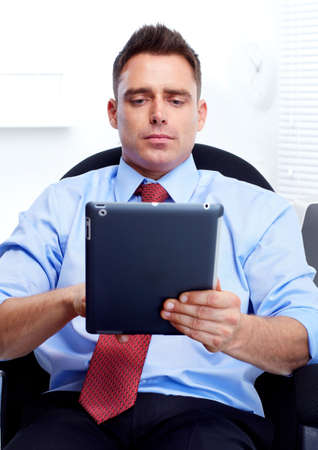 businessman with a tablet computer photo