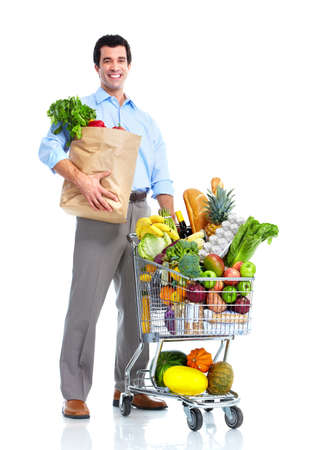 Happy man with a shopping cart. Stock Photo - 10733520